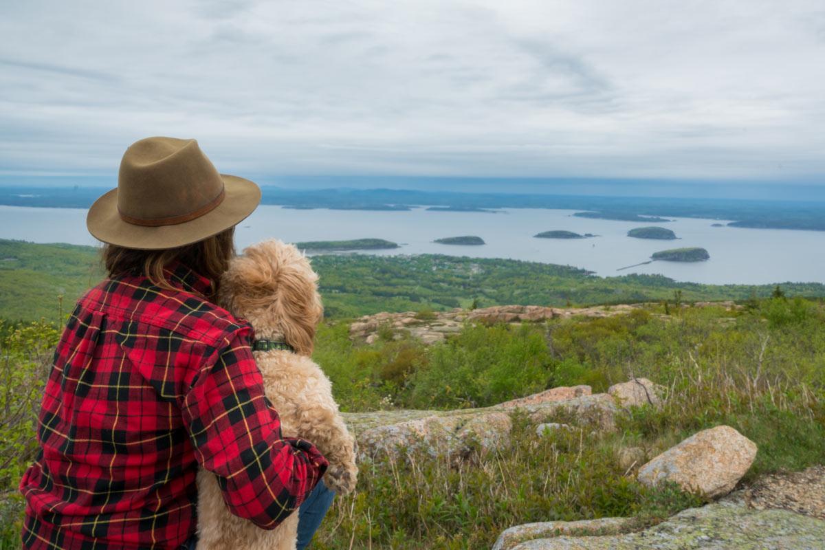 woman hiker, dog, Cadillac Mountain view of the Atlantic Ocean