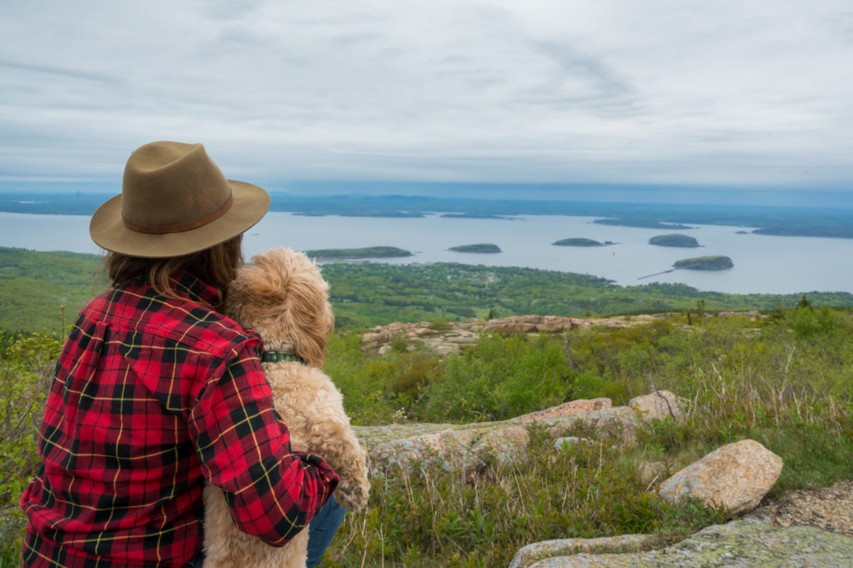 woman hiker, dog, Cadillac Mountain view of the Atlantic Ocean